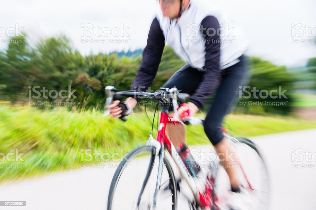 Fast Sport Bicyclist on bike with motion blur stock photo