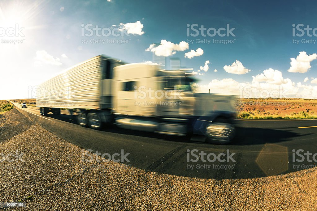 Fast Truck on Highway at Sunset royalty-free stock photo