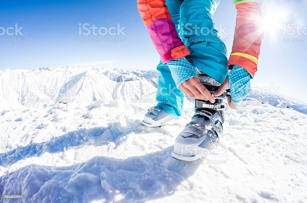 Fastening the ski boots stock photo