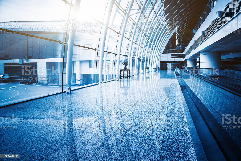 fast-moving walkway with people in the far distance stock photo