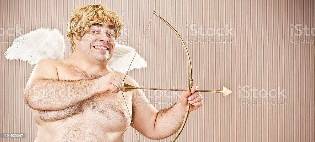 fat blonde cupid with bow and arrow aim for love royalty-free stock photo
