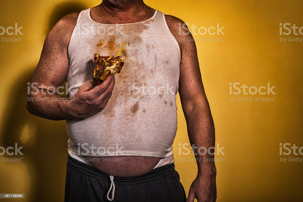 fat greasy man holding a slice of pizza stock photo