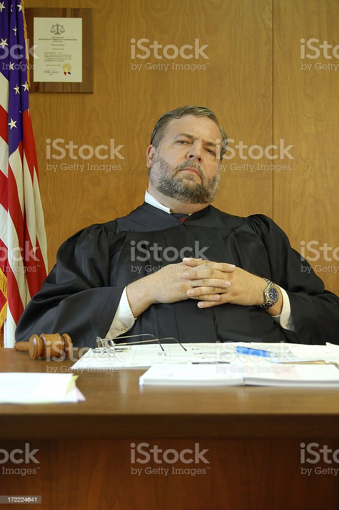 Fat Judge Sits Back And Listens stock photo