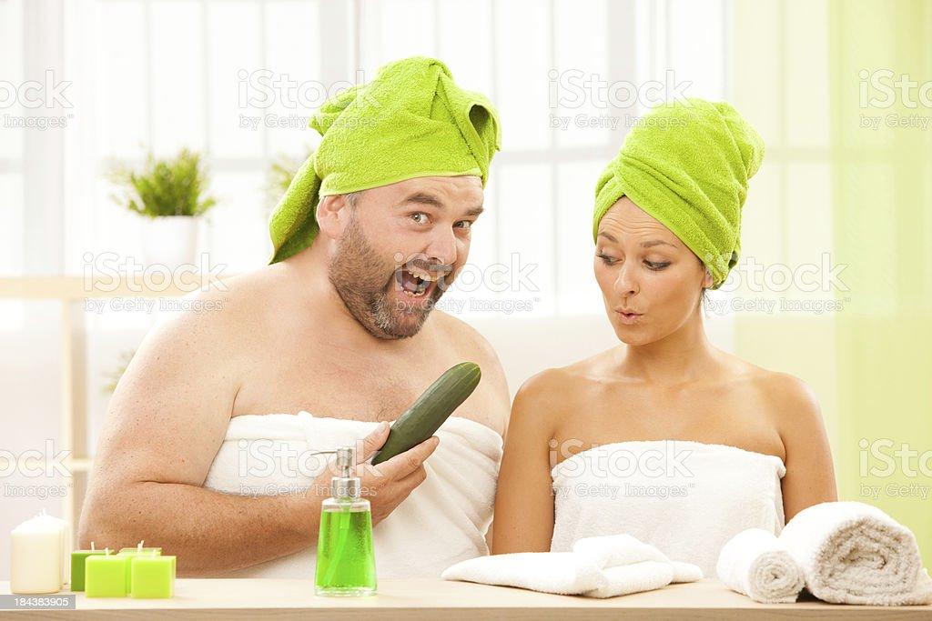 fat man and beautiful girl talk about beauty treatments stock photo