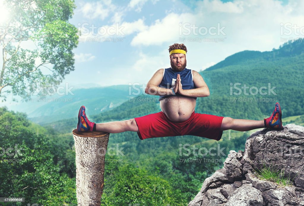 Fat man does the splits stock photo