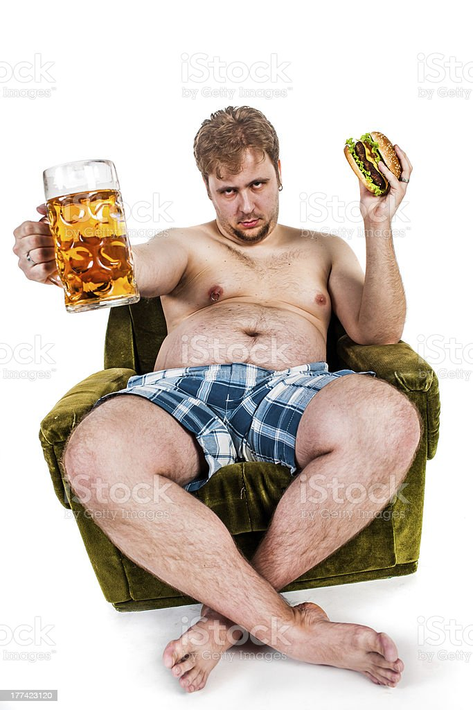 fat man eating hamburger royalty-free stock photo