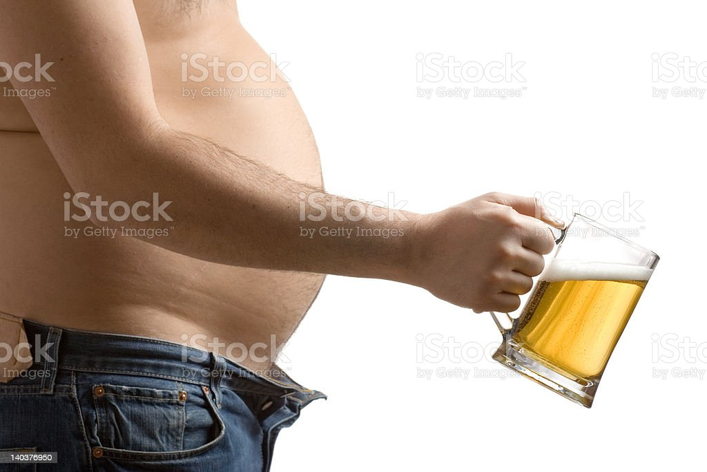 Fat man holding a beer glass royalty-free stock photo
