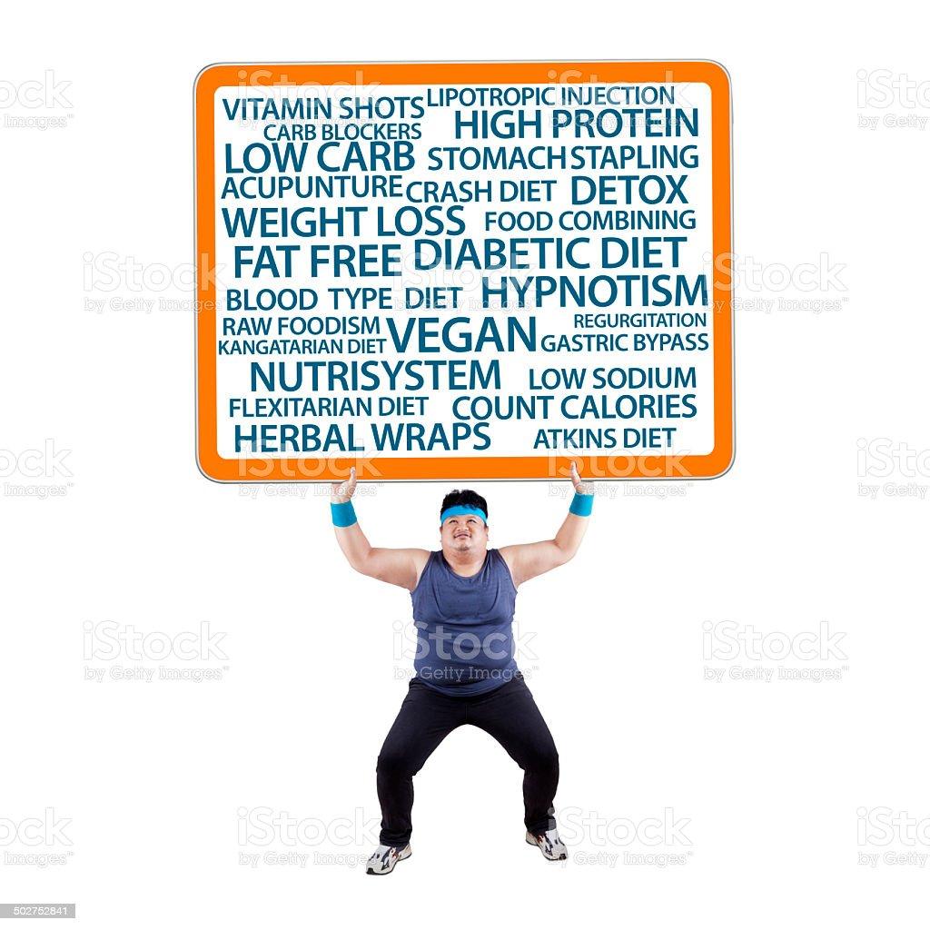 Fat man lifting a billboard stock photo