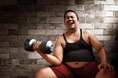 Fat man lifting weights