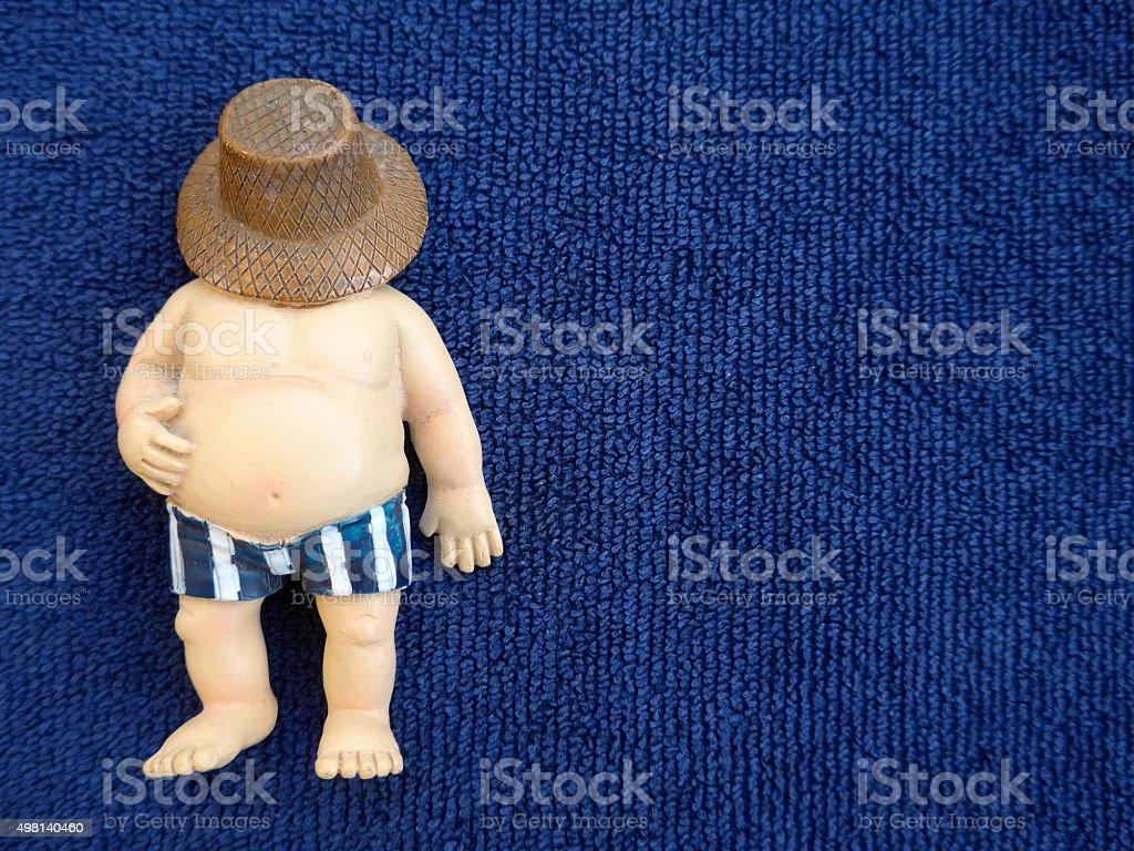 Grasa hombre en toalla-Bild-azul foto de stock libre de derechos