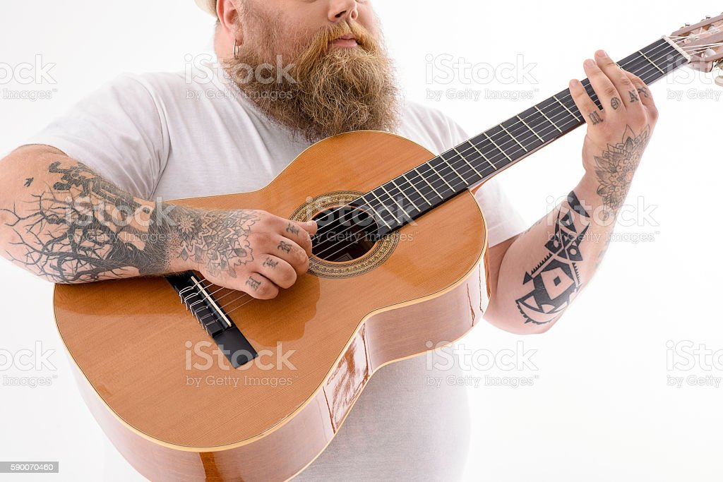 Fat man playing musical instrument stock photo