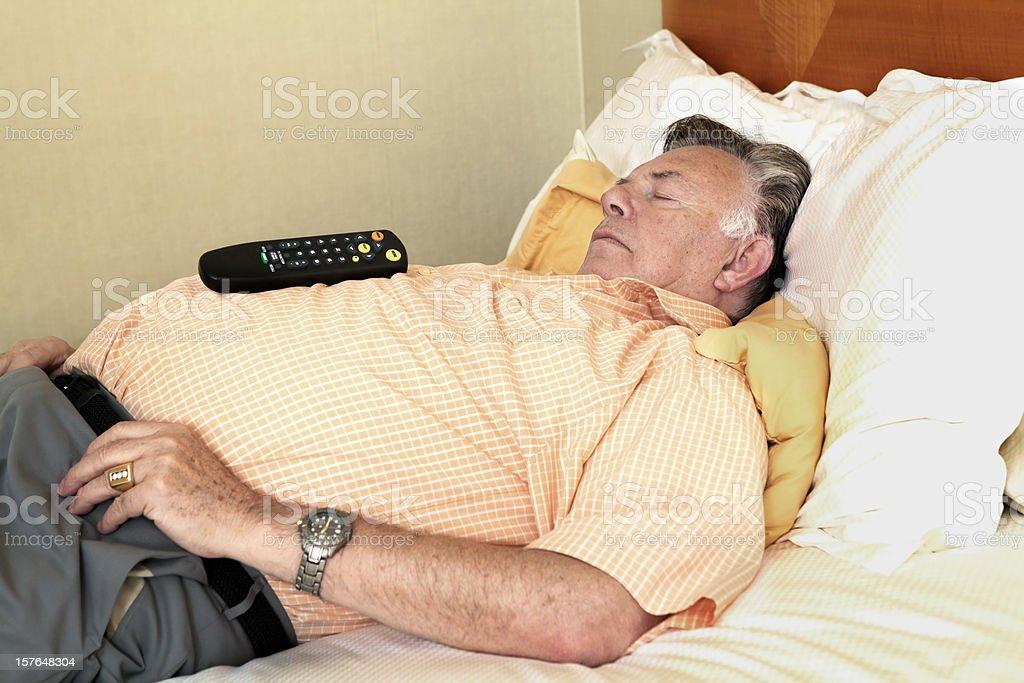 fat man sleeping stock photo