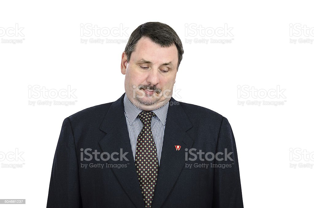 Fat man staring at the communist pin stock photo
