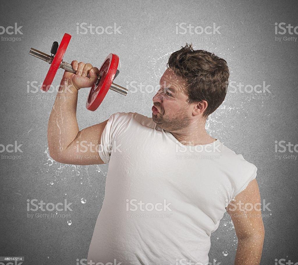 Fat man sweats stock photo