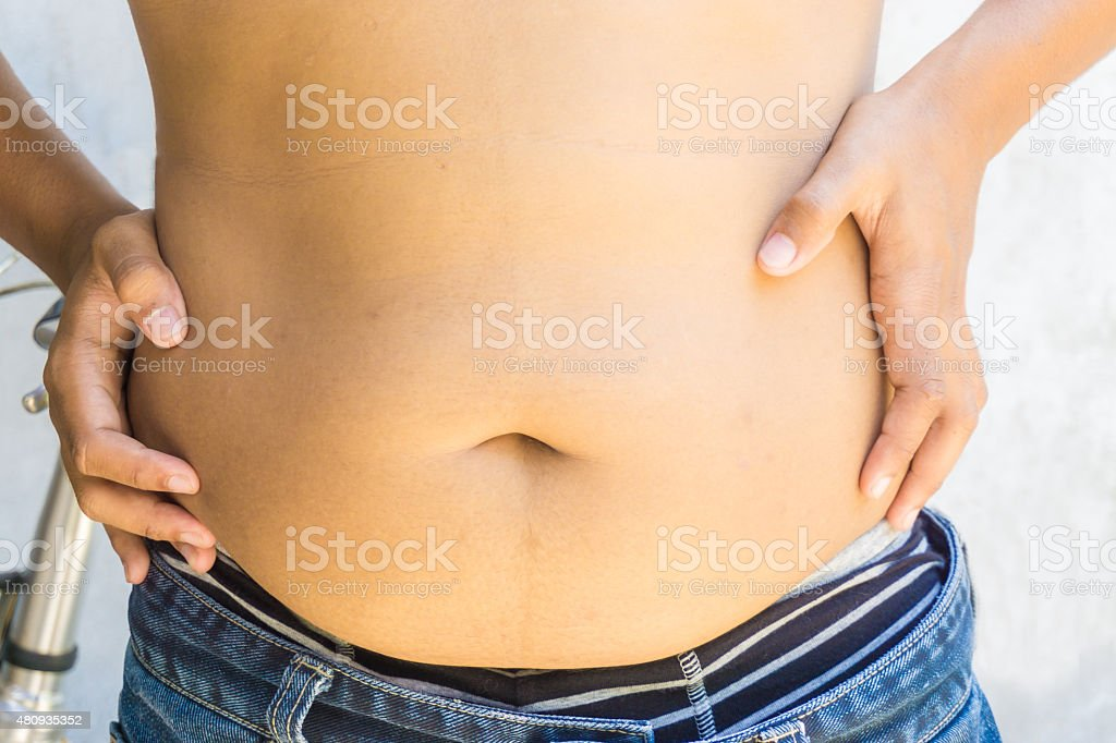 Fat man with a big belly. stock photo