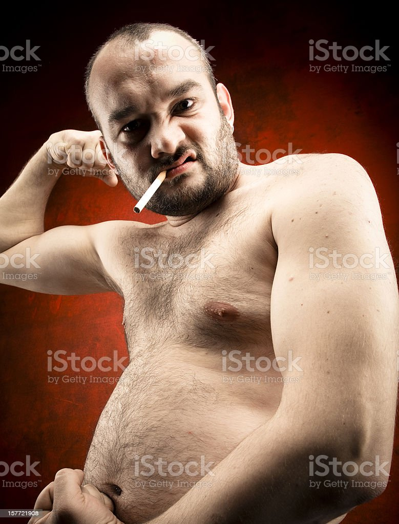 fat man with cigarette royalty-free stock photo