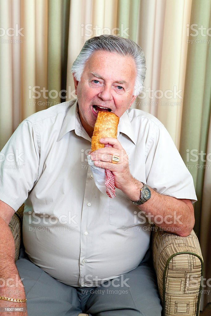 Fat Man with diabetes eating cake royalty-free stock photo