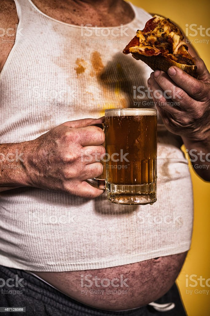 Fat old white man with Pizza and Beer stock photo