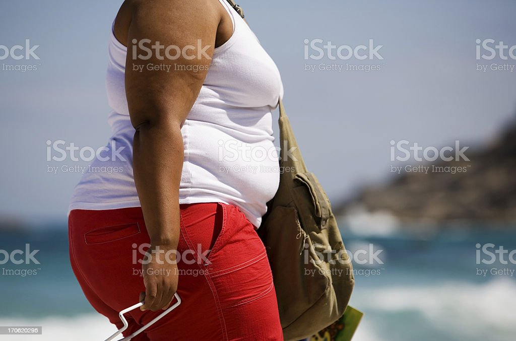 Fat woman at the beach stock photo