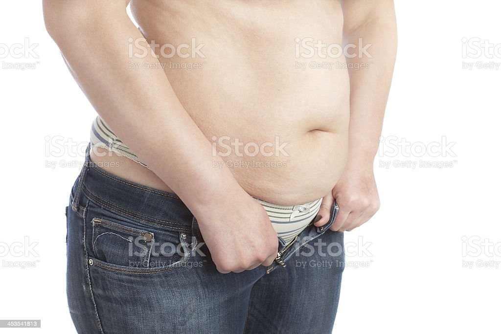 Fat woman can not wear jeans with excess fat. royalty-free stock photo