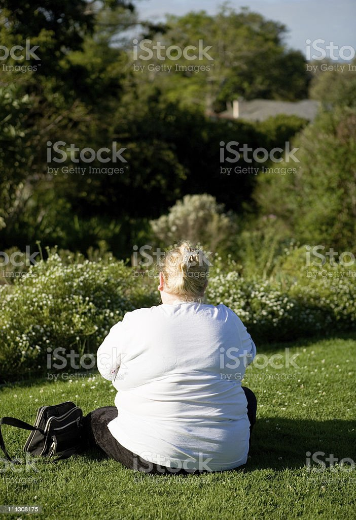 Fat woman contemplating stock photo