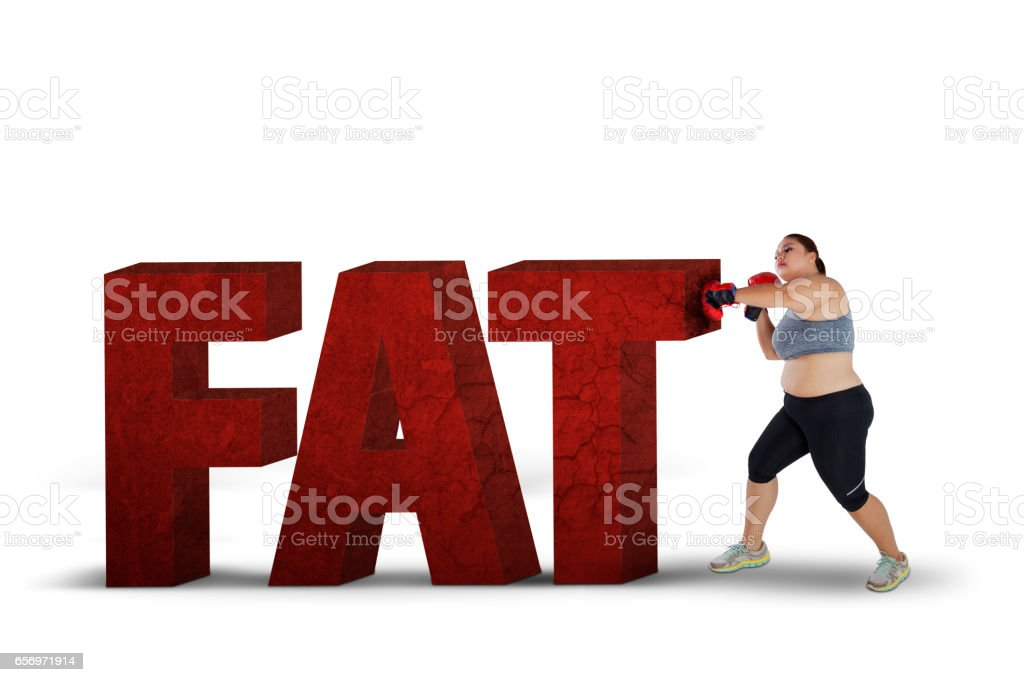 Fat woman fighting with fat word stock photo