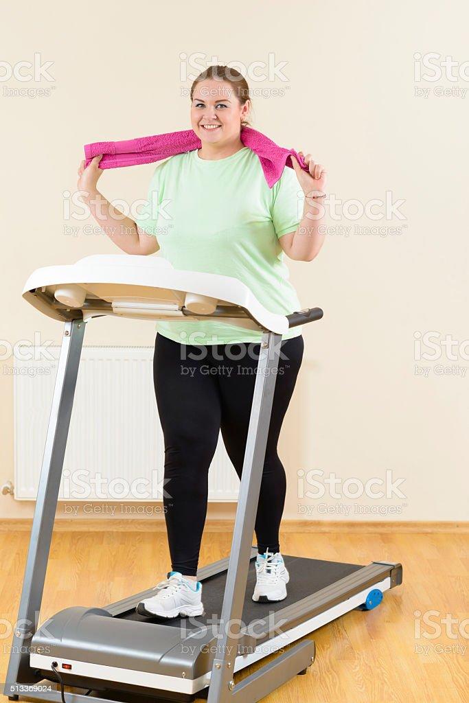Fat Woman Running Treadmill stock photo