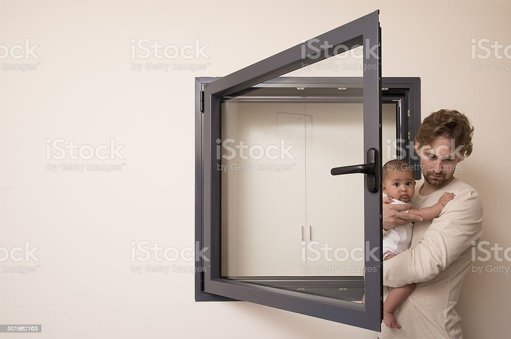 Father and baby at safe room. stock photo