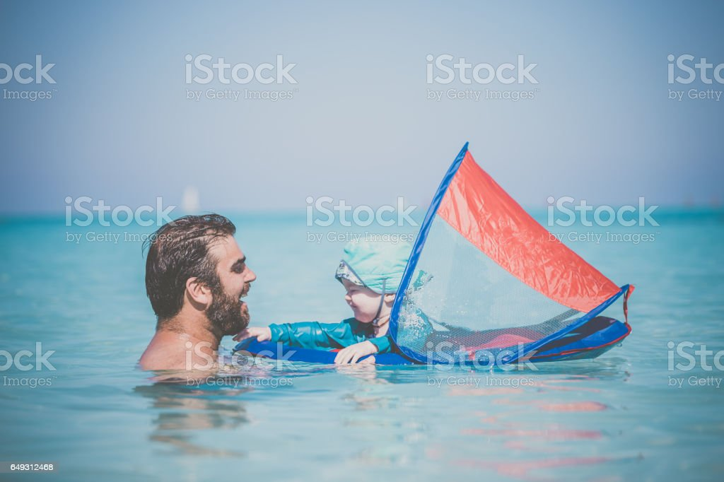 Father and Baby Boy Playing in Wayer on Tropical Beach stock photo