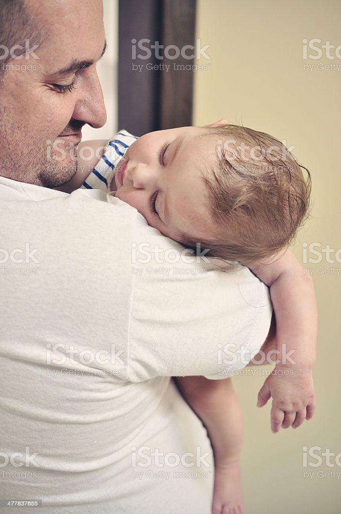 Father And Baby Daughter Sleeping On His Shoulder royalty-free stock photo