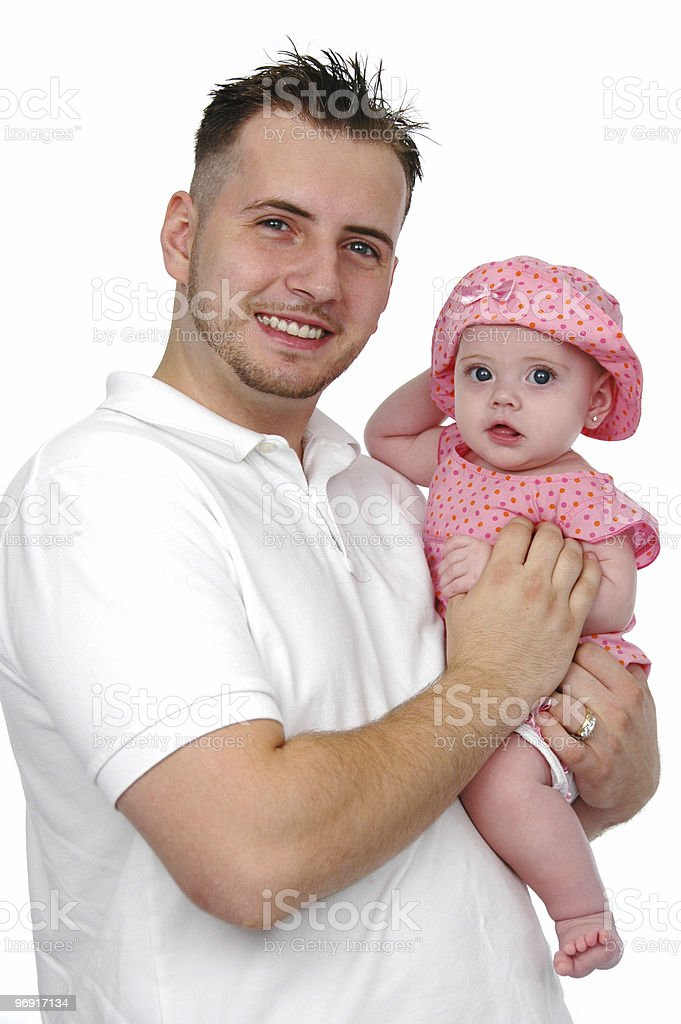Father and baby daughter smiling stock photo
