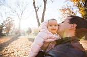 Father and baby girl in park