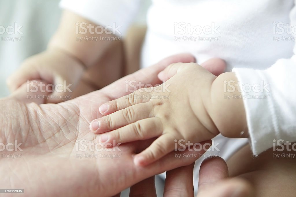 Father and Baby Hand Closeup royalty-free stock photo