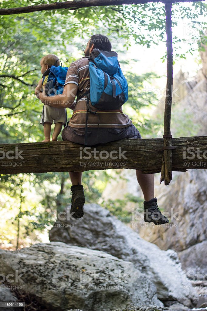 Father and baby on the wooden bridge stock photo
