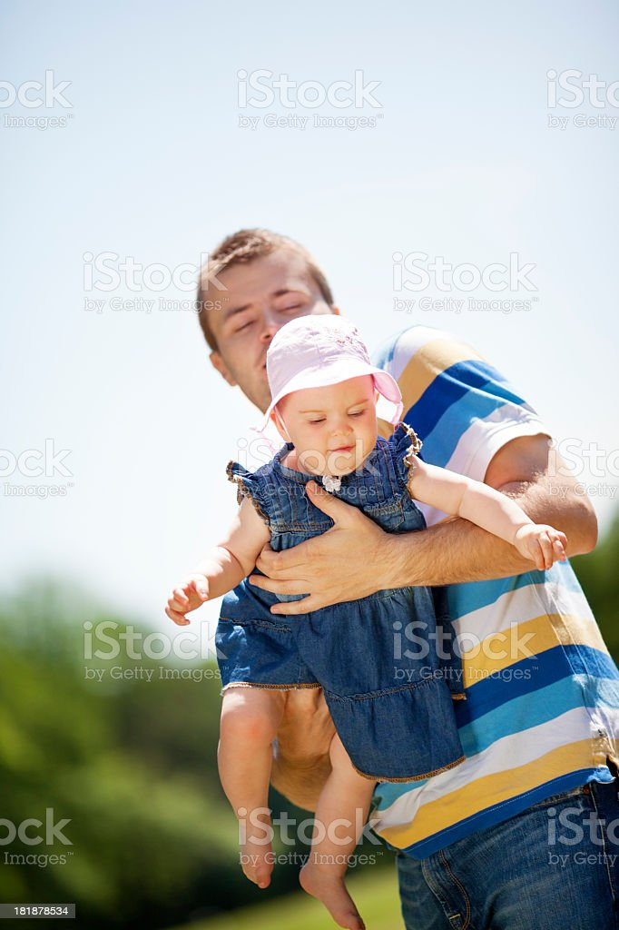 Father and baby outdoors. stock photo