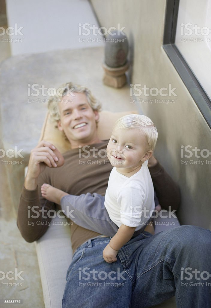 Father and baby relaxing on patio royalty-free stock photo