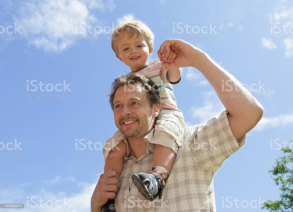 Father and baby son piggyback stock photo