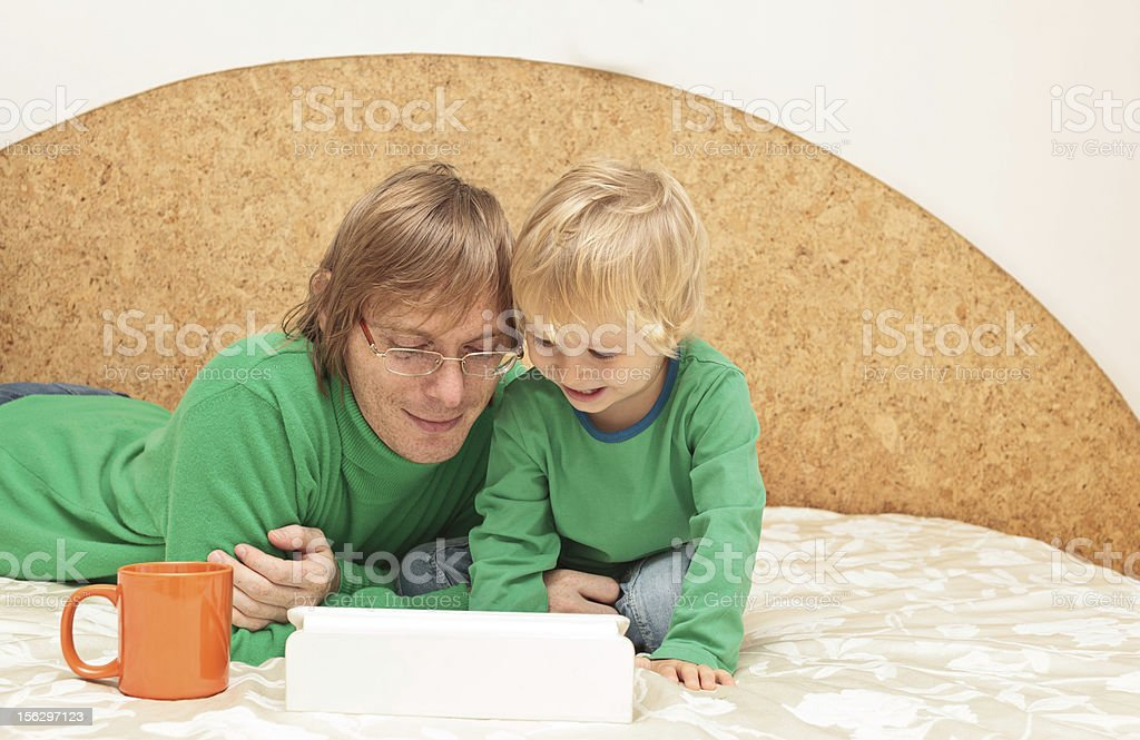 father and baby with touch pad at home royalty-free stock photo