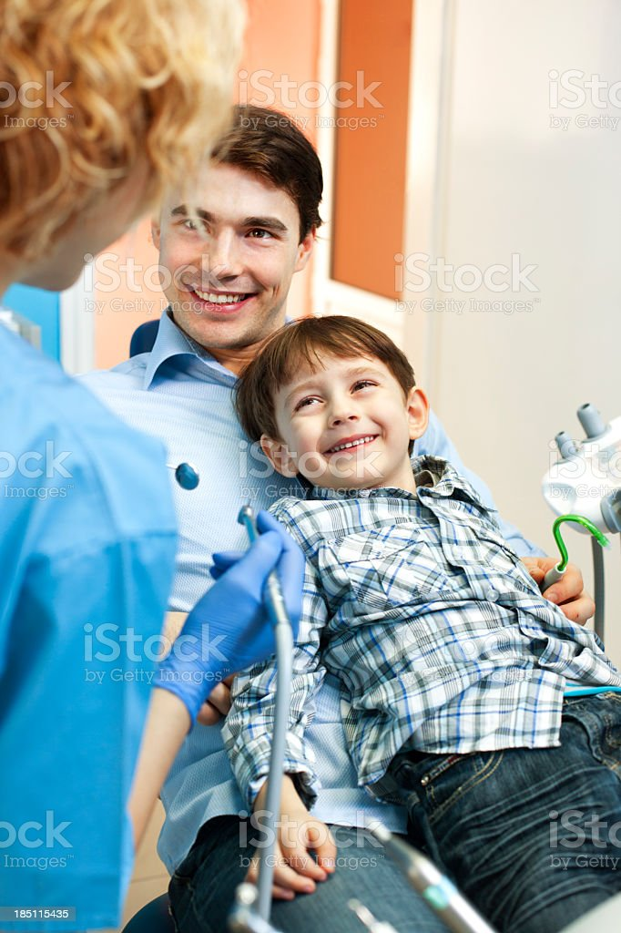 Father and child at dentist office royalty-free stock photo