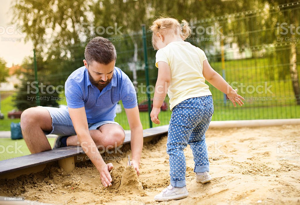 Father and child on playground stock photo