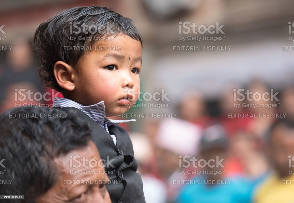 Father and child watching ceremony procession. stock photo