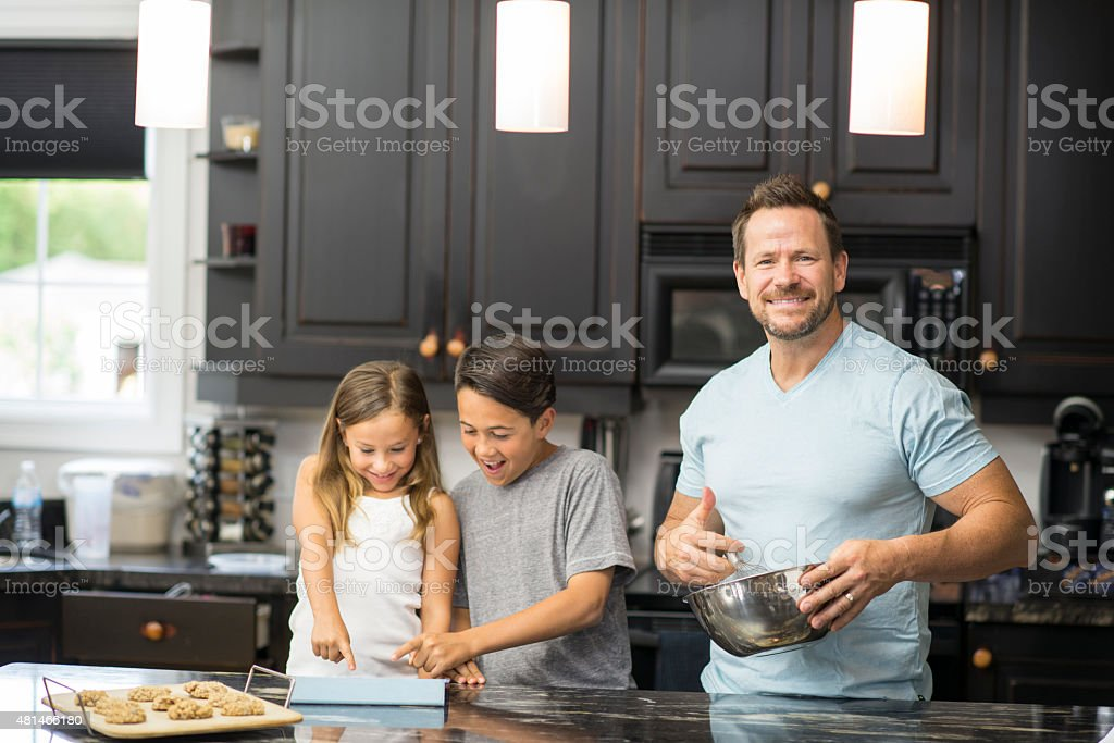 Father and Children Baking stock photo
