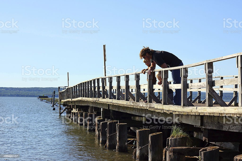 Father and Children on Pier royalty-free stock photo