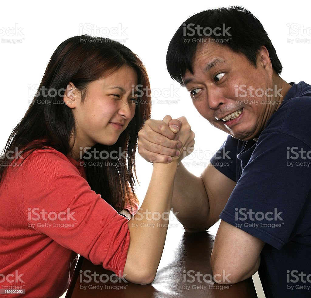 father and daughter arm wrestling royalty-free stock photo