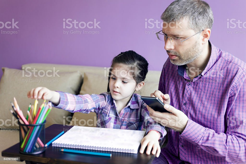 Father and Daughter at Home stock photo