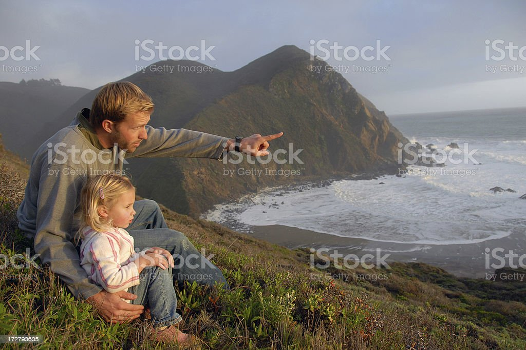 father and daughter at sunset royalty-free stock photo