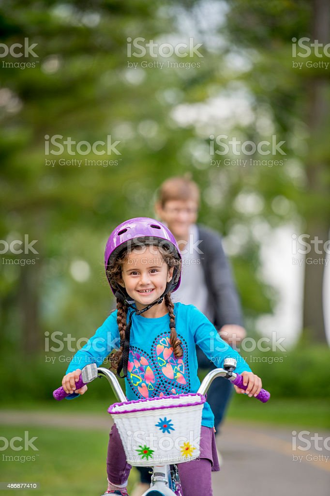 Father and Daughter Bike Riding stock photo