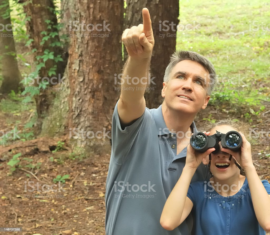Father and Daughter Bird Watching stock photo