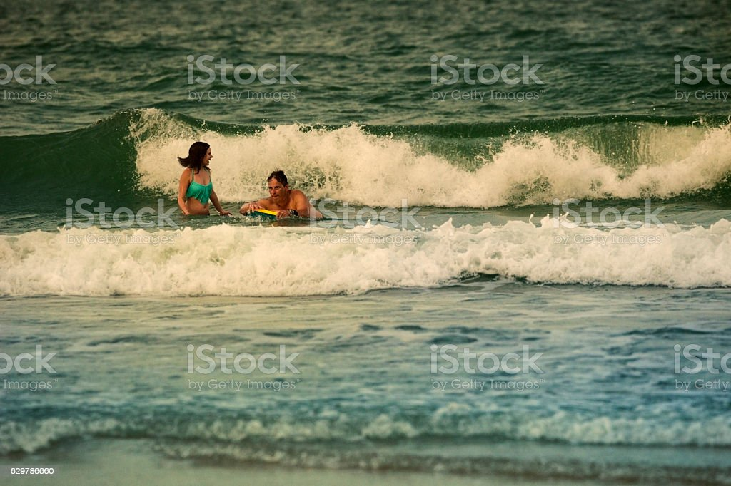 Father and daughter body surfing stock photo