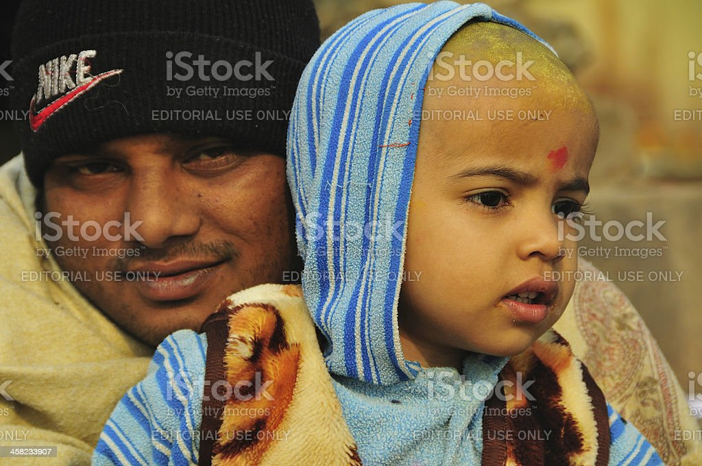 Father and daughter by the Ganges River royalty-free stock photo